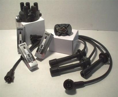 Suzuki Tune-up Kit #2. Distributor Cap, Distributor Rotor, Spark Plugs (1 set), Plug Wires